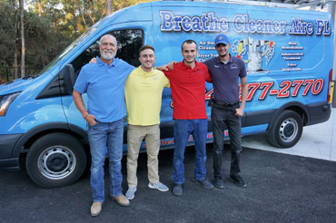 air duct cleaning company employees help each other